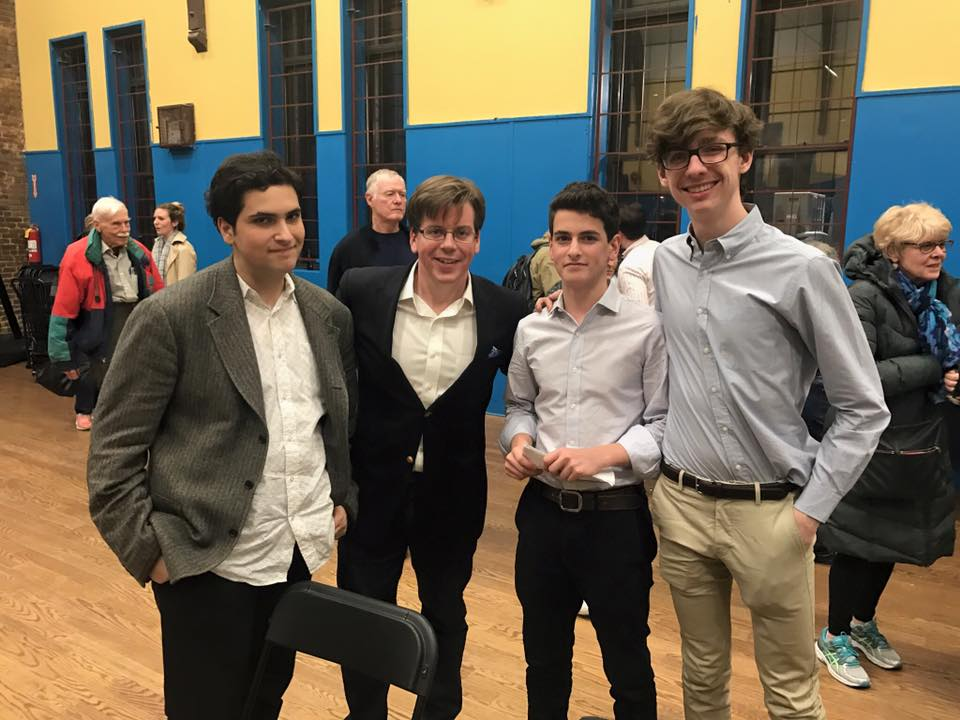 Max, Assemblyman Robert Carroll, Eli, and Chris (from left) at this month's CBID meeting