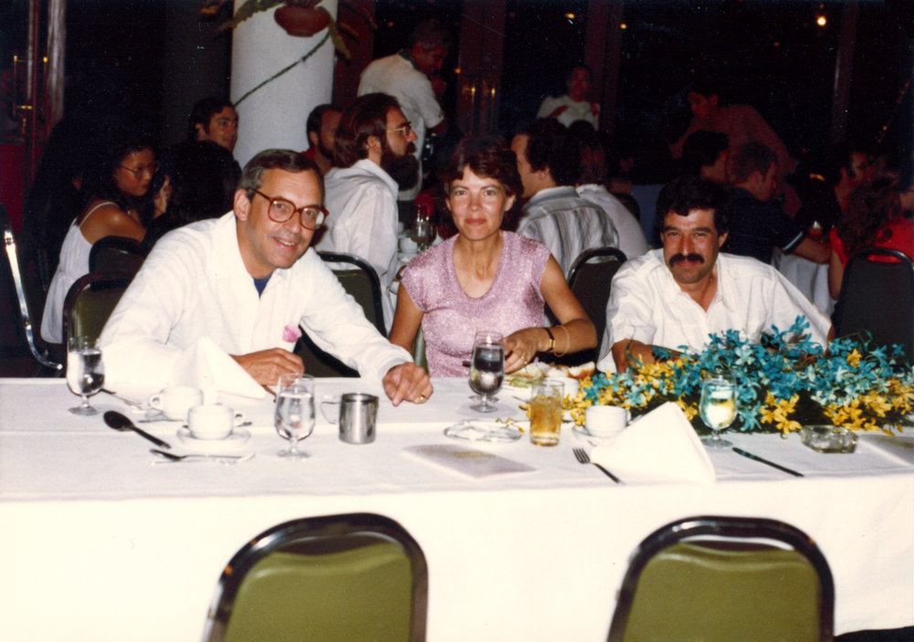 DeVecchi and Rosenblatt  Robert P. DeVecchi (left), Ann Rosenblatt (center), and Lionel Rosenblatt (right). Taken by Toni Barila at a JVA Christmas Party in December 1980 is Bangkok Thailand.  Picture courtesy of Lionel and Ann Rosenblatt.