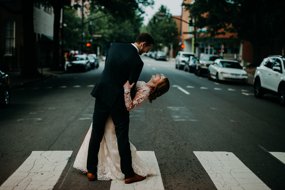 bride and groom dancing in street in downtown Raleigh