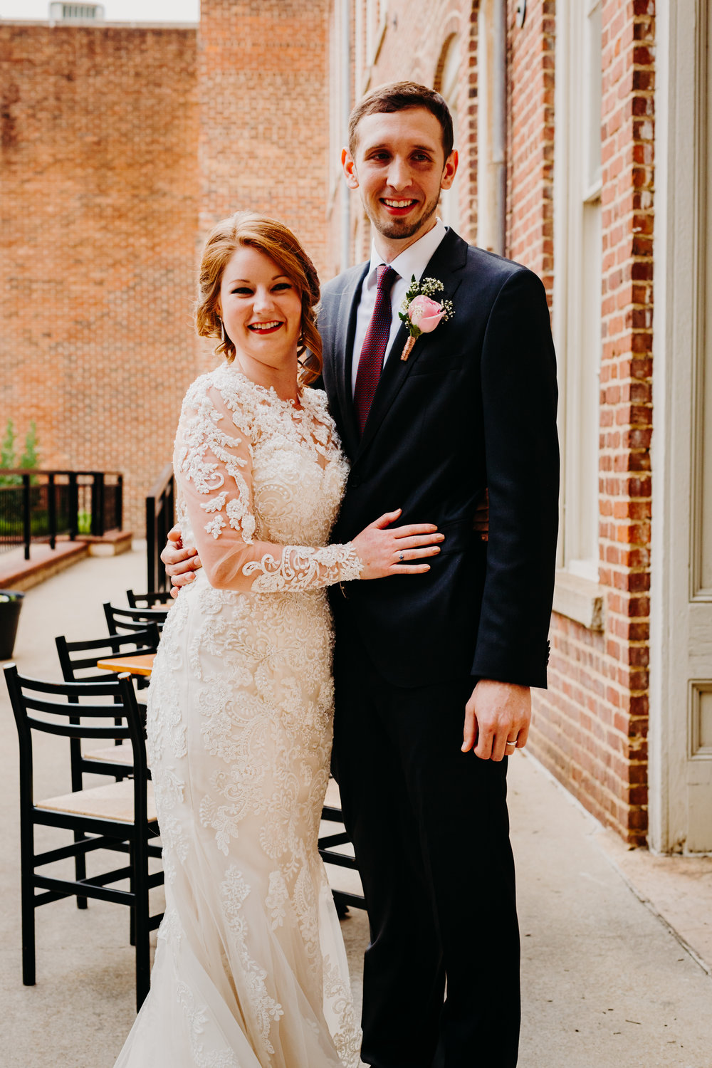 Bride and groom after ceremony downtown Raleigh wedding