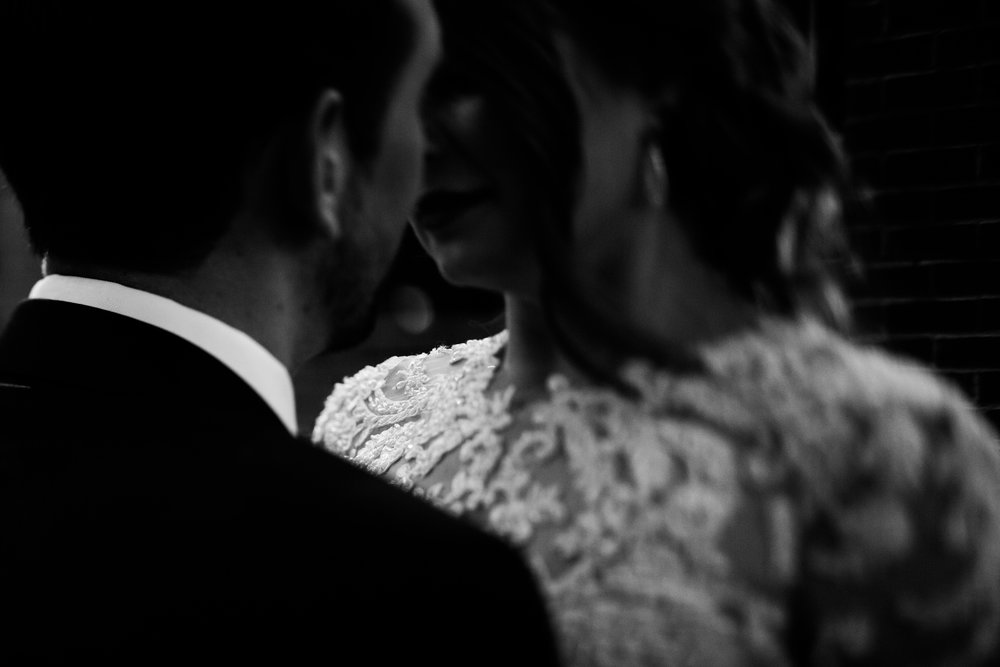 intimate moment between bride and groom at night, downtown Raleigh wedding