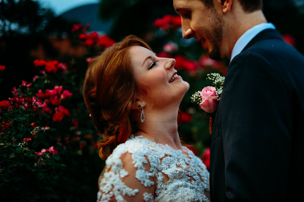 Bride and groom documentary style photos after ceremony downtown Raleigh wedding
