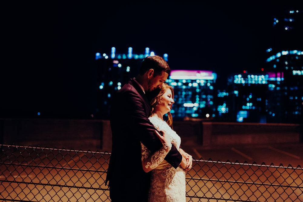 Night Time roof top shot of bride and groom in downtown Raleigh