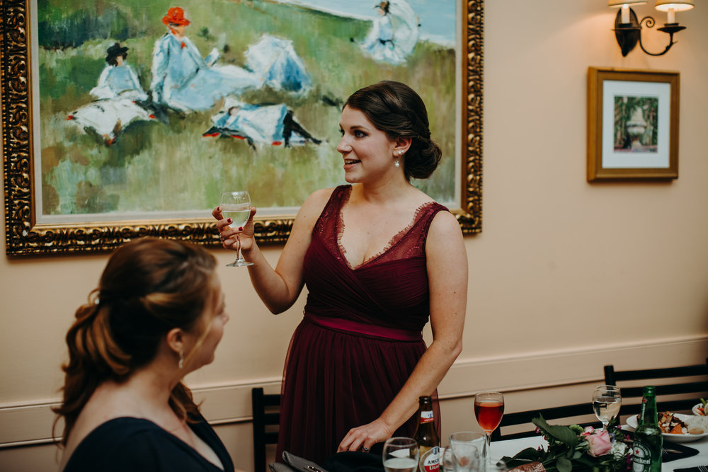 Maid of Honor gives toast at reception Bride and groom documentary style photos after ceremony downtown Raleigh wedding