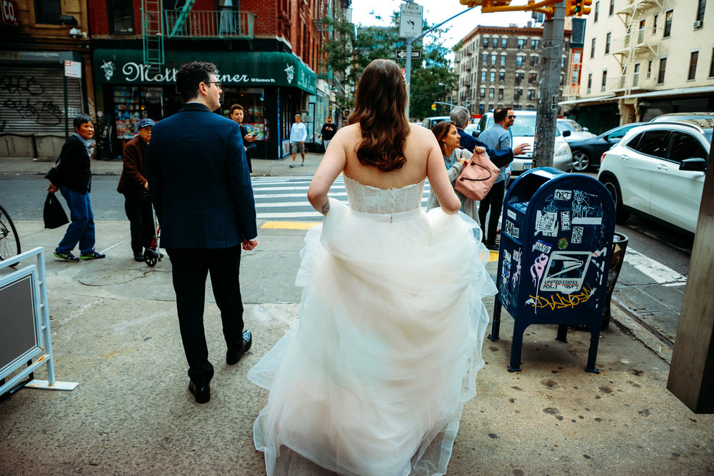 bride and groom walking the streets of New York city