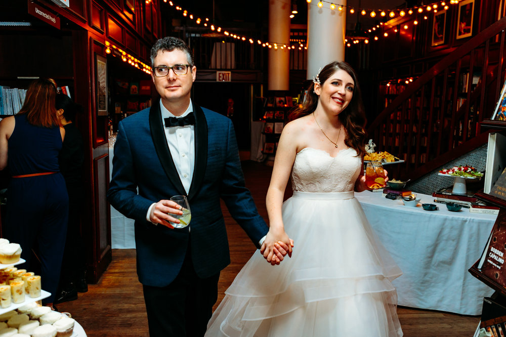 Love this little wedding at the Housing Works Bookstore in Chelsea. As a New York Wedding Photographer I have so many opportunities to shoot in really unique wedding locations around New York City. This image is of a bride and groom doing their first entrance as husband and wife.