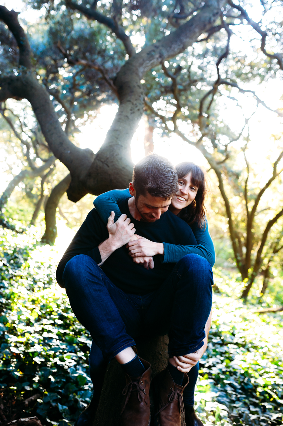 Couple climbing in to tree during a lifestyle shoot in San Francisco, California with New York Wedding Photographer