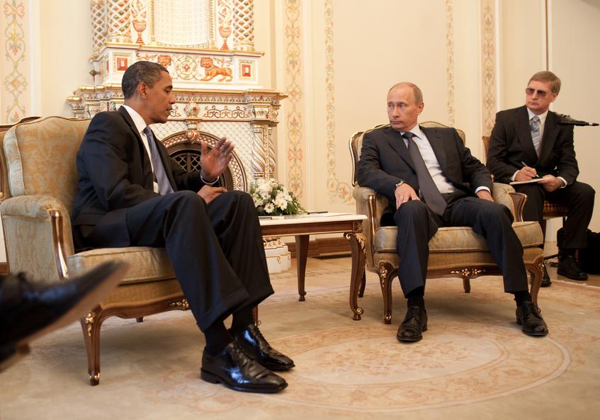 Putin manspreading in front of Barack Obama