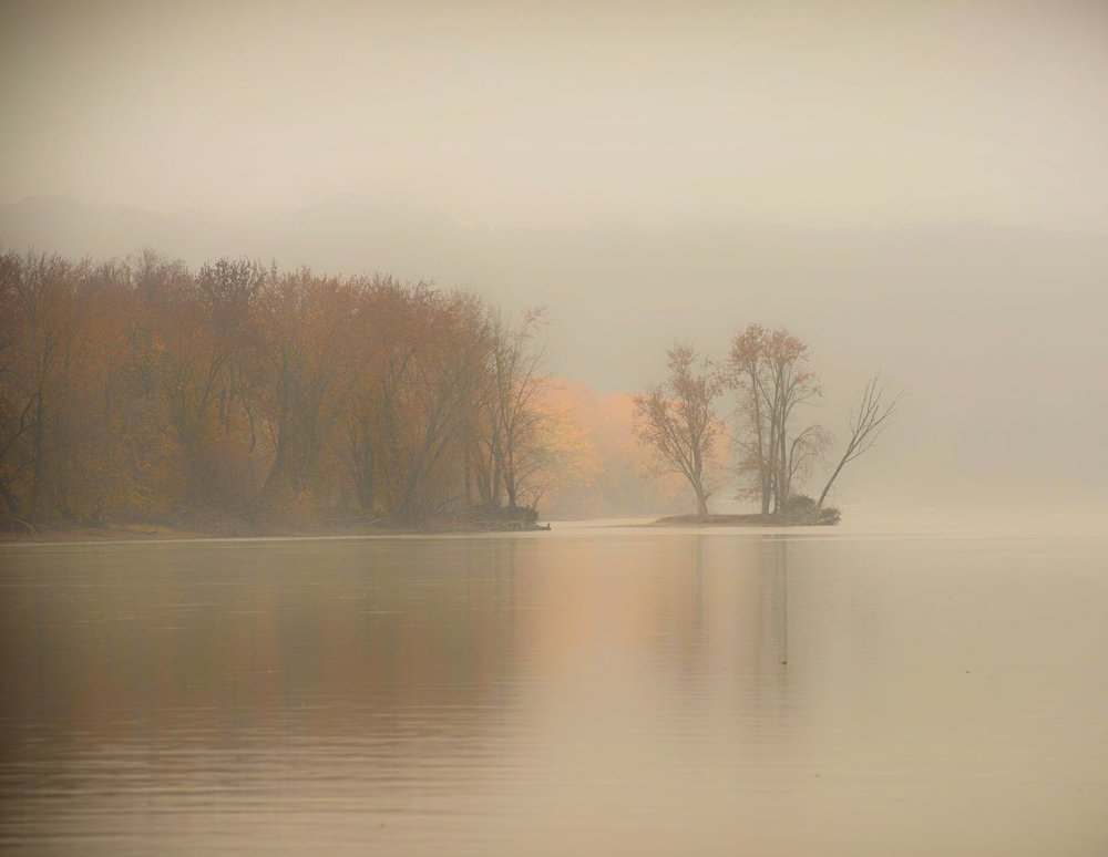 A bank of fog begins to lift on the Mississippi River near Prairie Du Chien, Wisconsin.