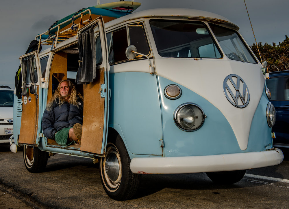 Richard Aguirre relaxes in his vintage Volkswagen van while enjoying the last rays of the sun on Sunset Cliffs Boulevard in Ocean Beach, California.