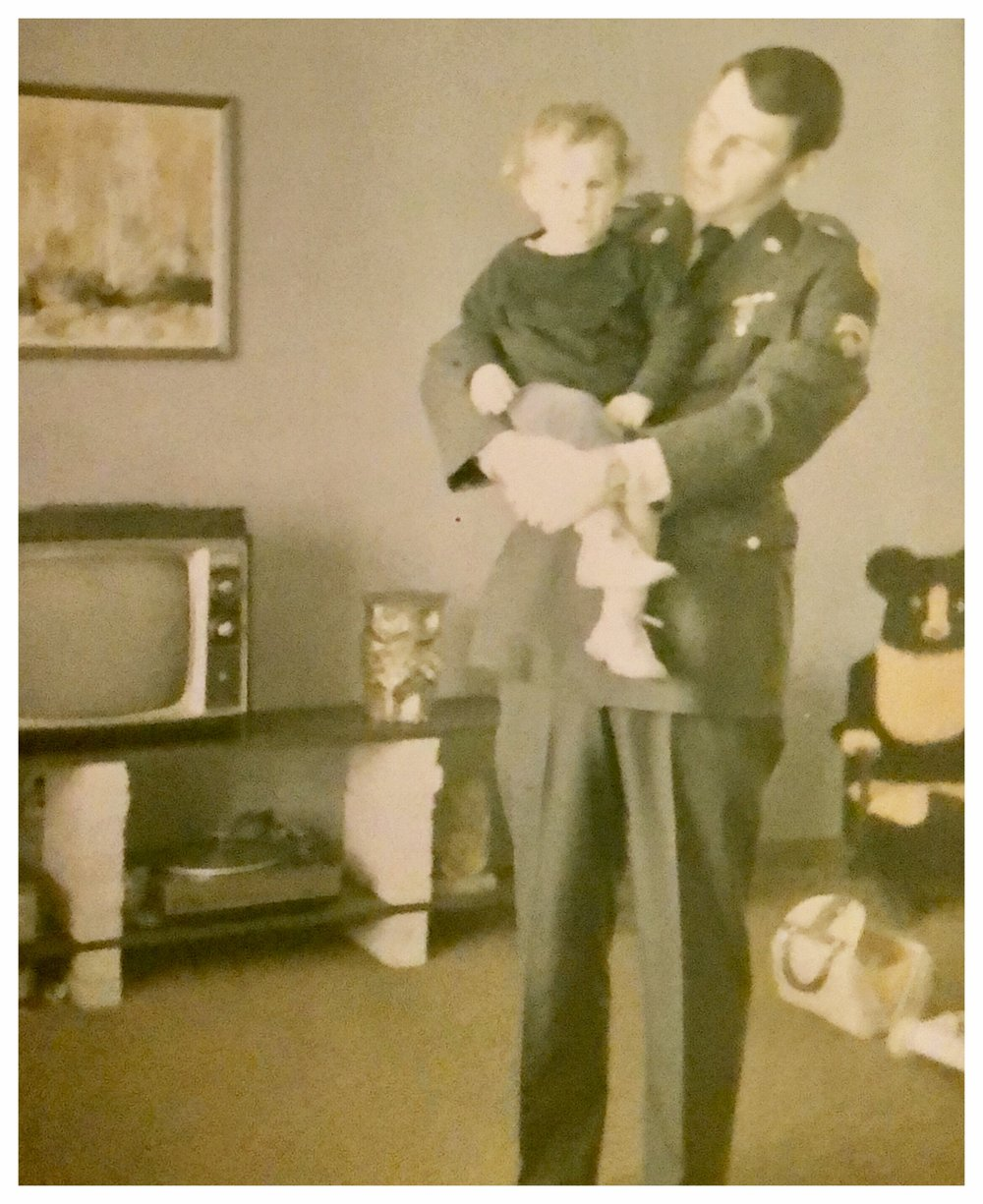 My father holding my sister at our home in Forest City in 1970.
