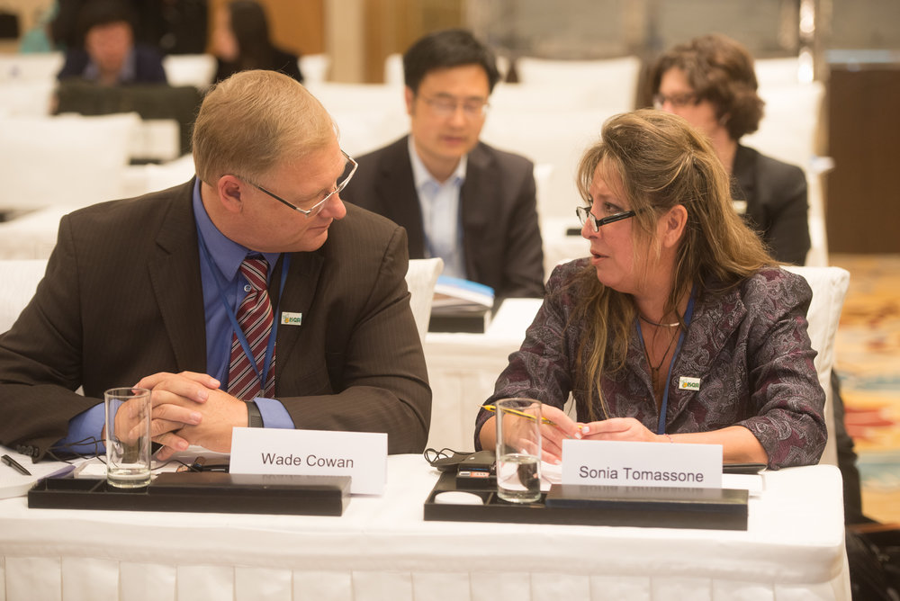 Wade Cowan, President of the American Soybean Association, and Sonia Tomassone,a trade consultant for the Paraguayan Grains and Oilseed Exporters Association, discuss biotechnology issues last week at an ISGA meeting in Beijing, China. (Photo: Joseph L. Murphy)