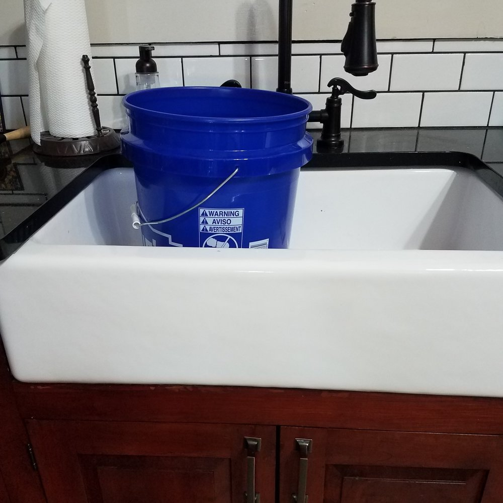 Just put a big ole bucket in my kitchen sink