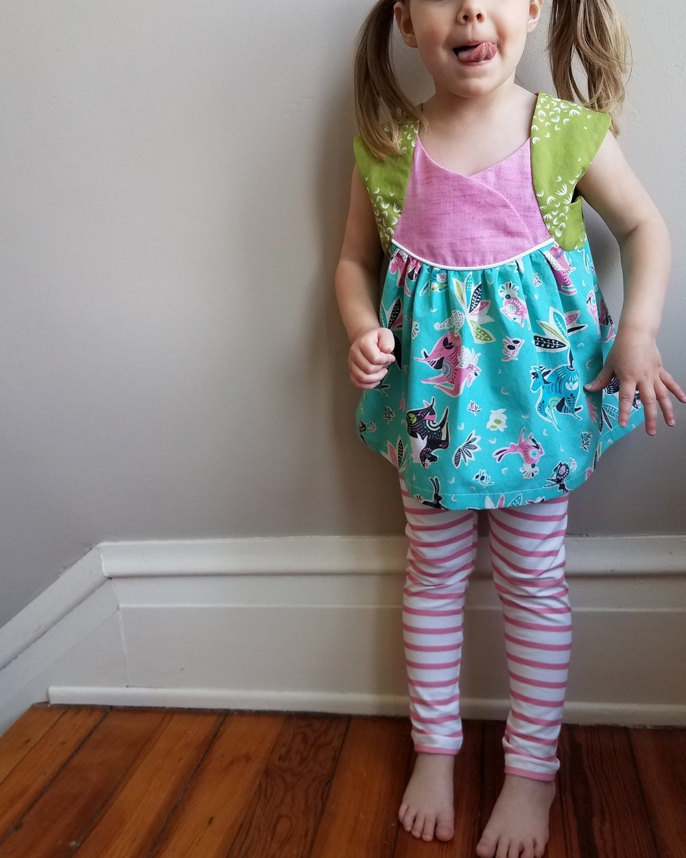 Modeled with coordinating mama-made leggings.