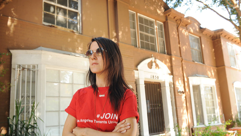Sylvie Shain stands in front of a Cherokee Avenue apartment building that is being converted into a hotel. (Christina House / For The Times)