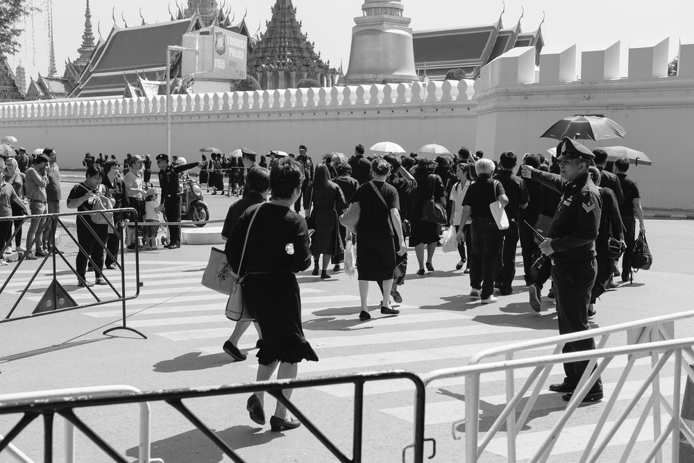 People wore black and waited in line for hours to pay their respects to King Bhumibol Adulyadej.