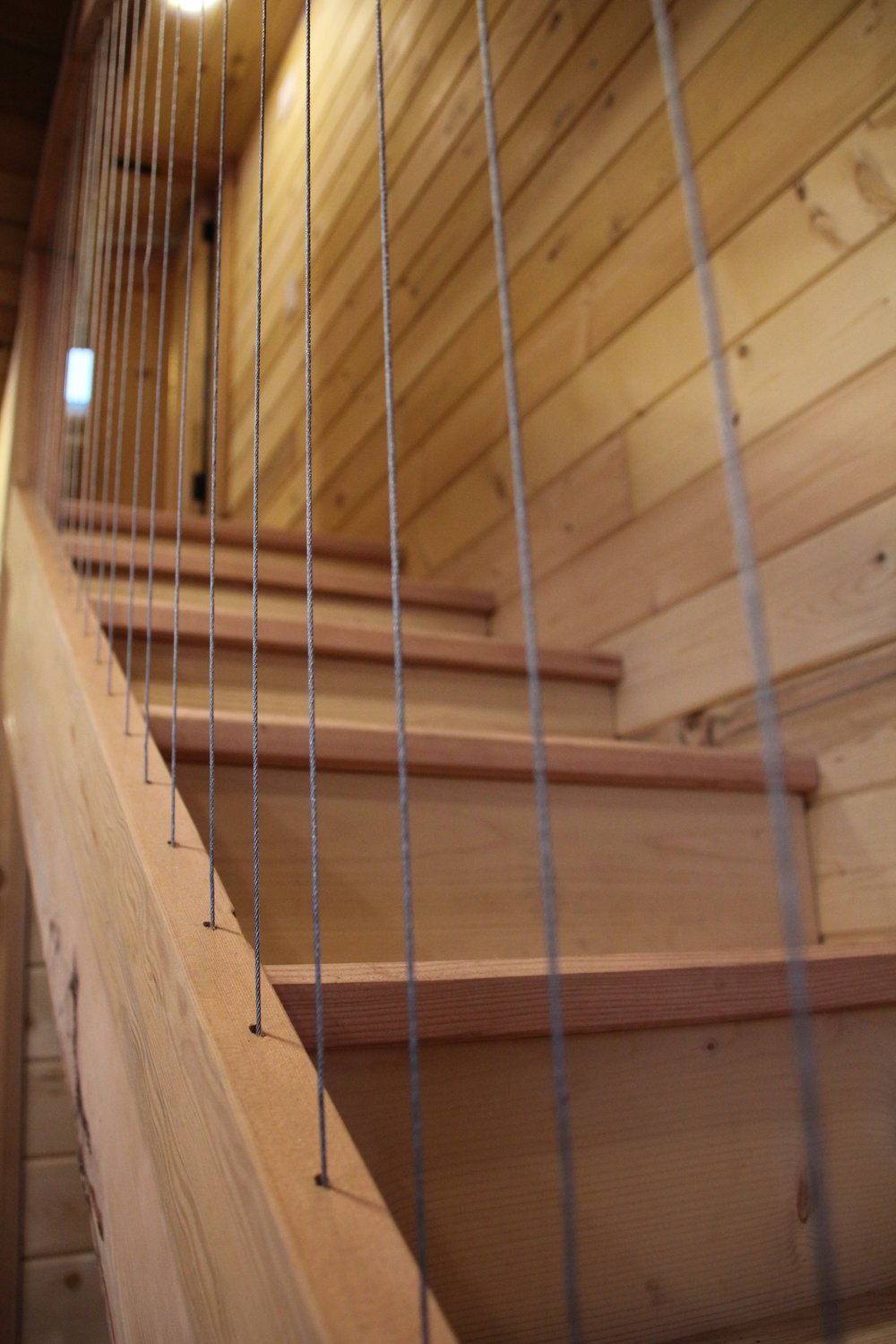 The use of catenary wire gives the stairs an open feeling while keeping it safe for the wee ones.