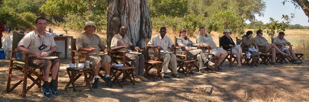 Lunch time. Looking out across the Luangwa river while elephants, crocodiles and hippos come to say hello. As you can see, these safaris are tough!