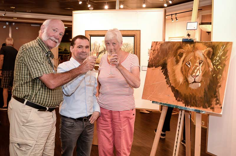My demonstration painting was sold too.  Me with happy customers.