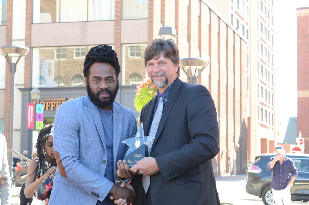 Brampton councillor Jeff Bowman presented the city's Walk of Fame award to reggae singer Exco Levi