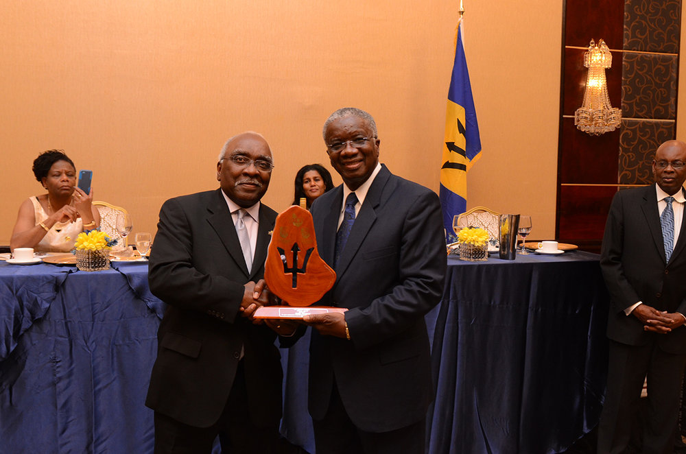 Barbados Prime Minister Freundel Stuart presented the Trident Award to Hugh Graham.