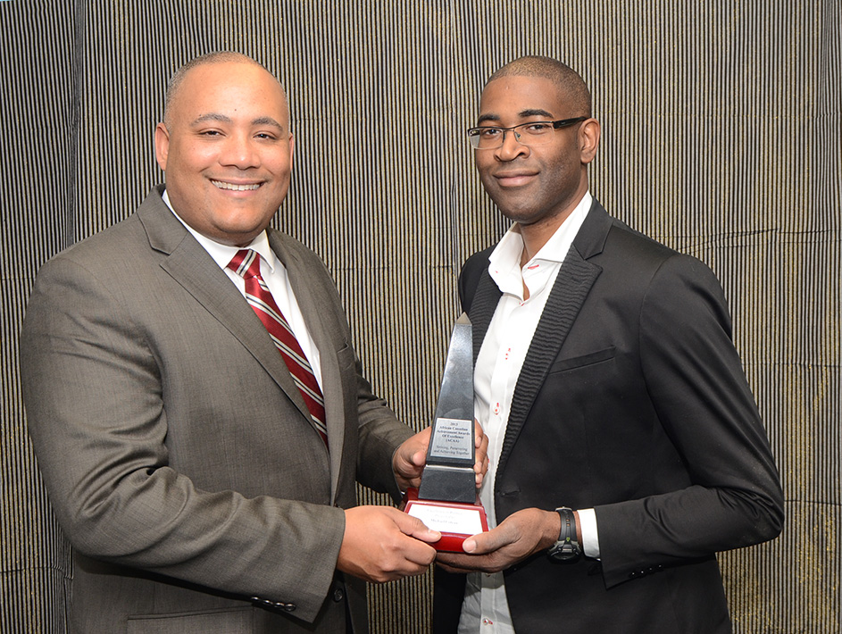 Sudz Sutherland presents the ACHA to Michael Coteau