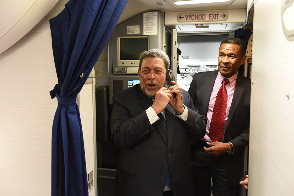 Prime Minister Ralph Gonsalves welcomes passengers on the inaugural flight from Toronto to St. Vincent's new Argyle International Airport. In the background is consul general Fitz Huggins who was on the flight.