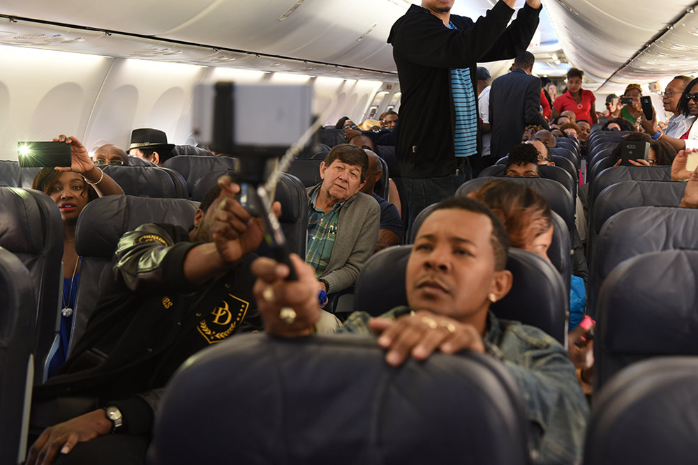 Sunwing passengers recording the historic moment