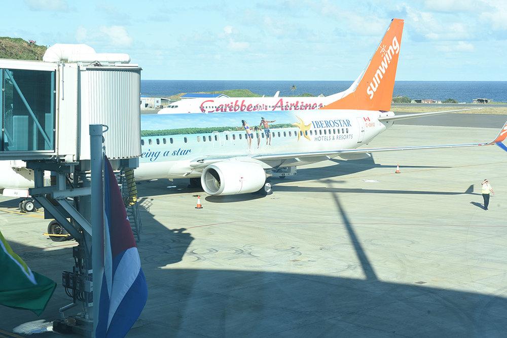 Sunwing and Caribbean Airlines inaugural flights at jet bridges
