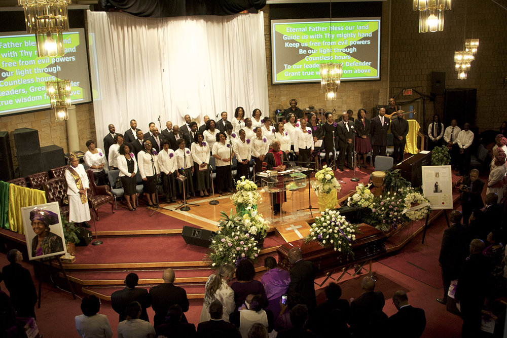 Rev. Dr. Audley James conducts the service at Walker's funeral