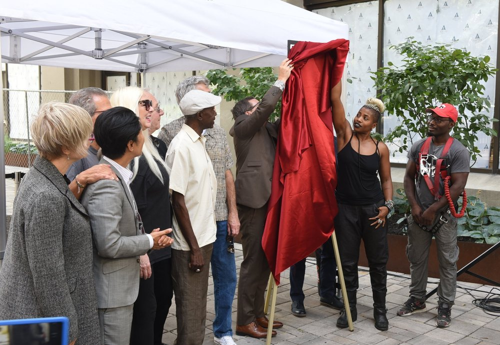 SATE, the daughter of Salome Bey, assisted with the unveiling of the mural