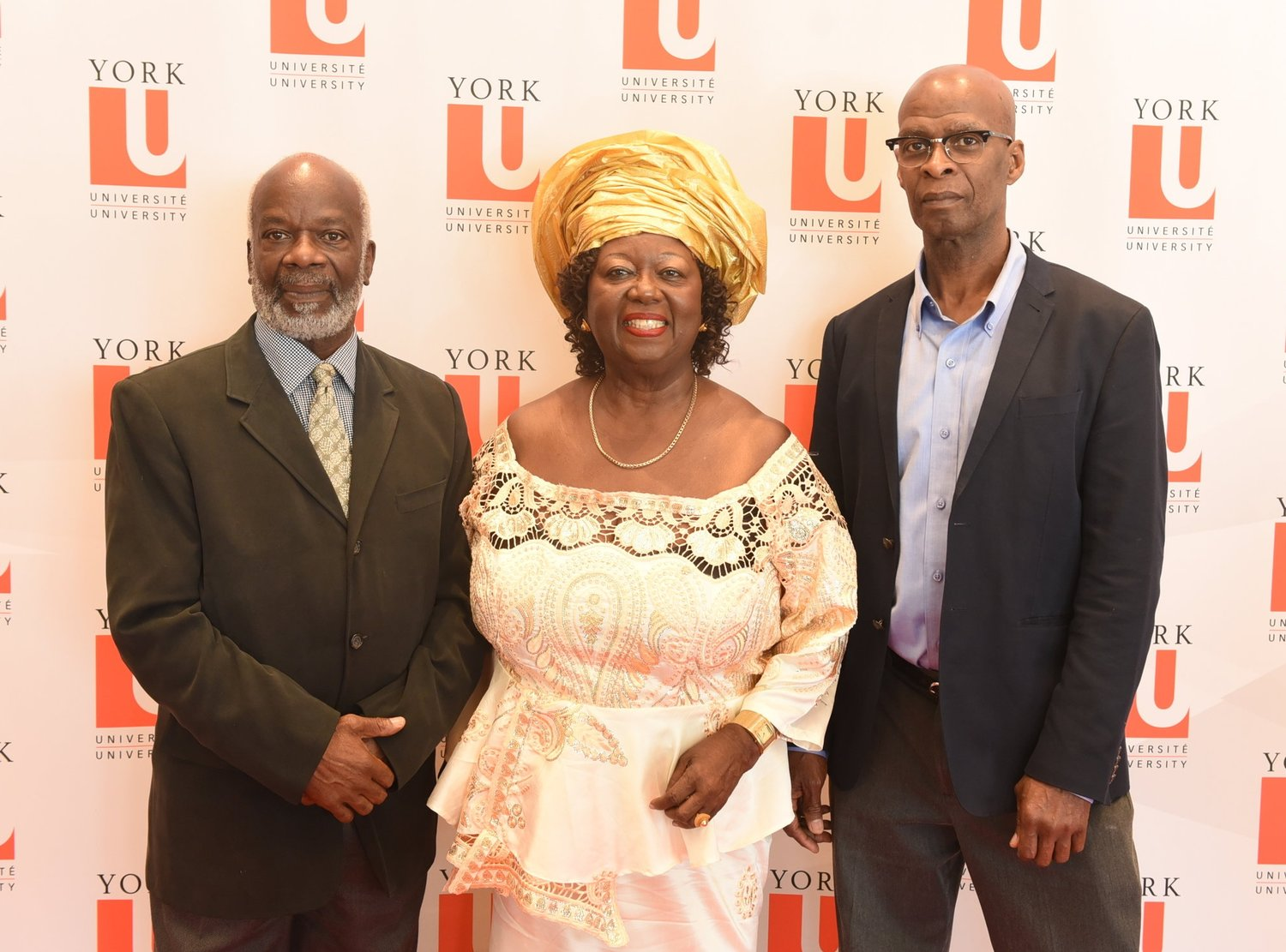 Jean Augustine flanked by actor Joseph Marcell (l) and Dr. Carl James