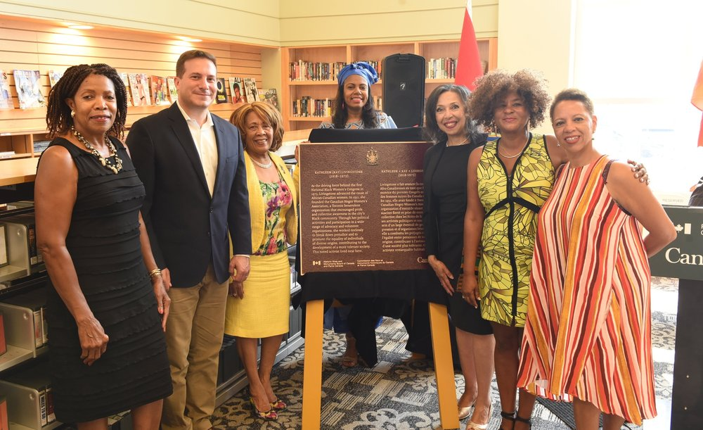 Loris Thomas (l), MP Marco Mendicino, Ettie Rutherford, OBHS first VP Kathy Grant, Rosemary Sadlier and Livingstone's daughters Rene and Kathy