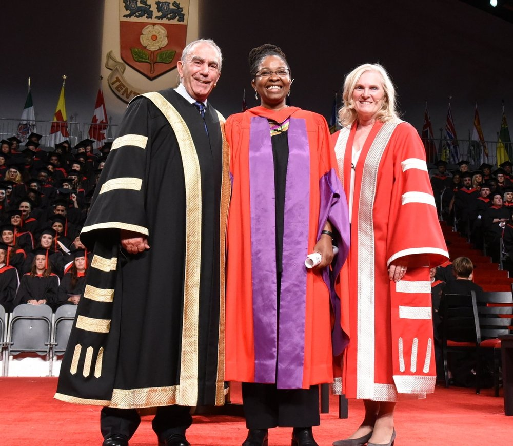 Angela Robertson flanked by York University chancellor Gregory Sorbara and president & vice-chancellor Dr. Rhonda Lenton