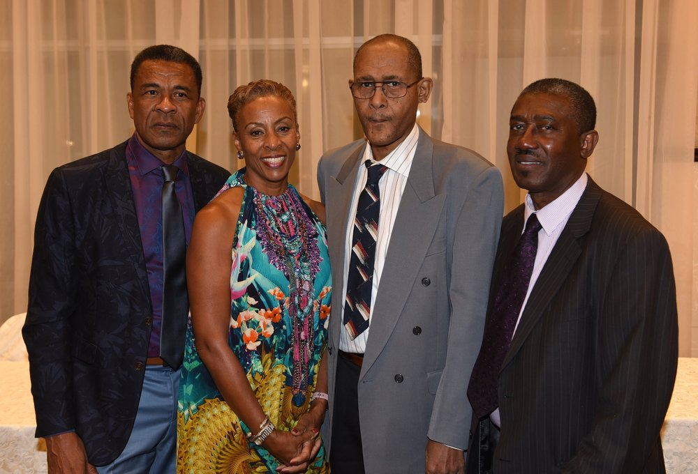 St. Vincent & the Grenadines consul general Fitzgerald Huggins (l) and SVGAT president Gideon Exeter (r) flank Camille Liverpool-Barnett and Ronald Liverpool