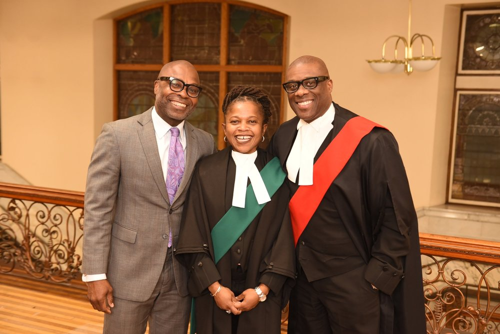 New JP Judith Montreuil flanked by Ainsworth Morgan (l) and Justice Donald McLeod