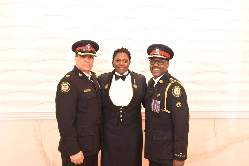 Chief Mark Saunders (r) and Superintendent Shaun Narine with Inspector Sonia Thomas