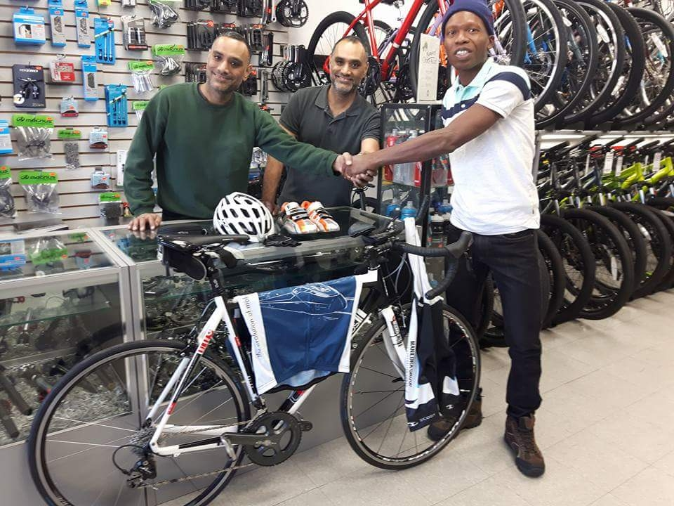 Twins Rick and Rob Din presented Walter Grant-Stuart with a new bike and accessories