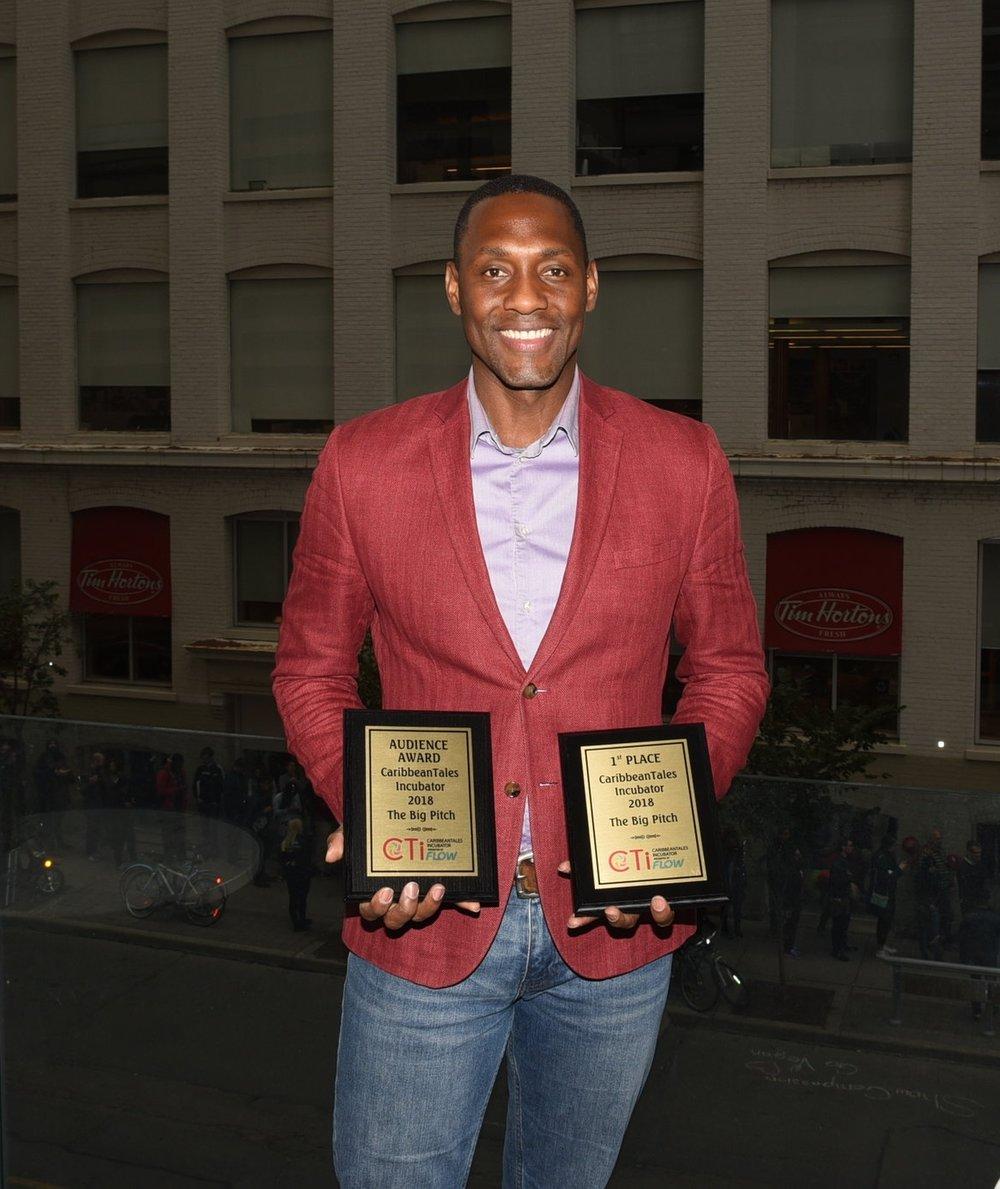 Paul Pryce proudly displays his awards