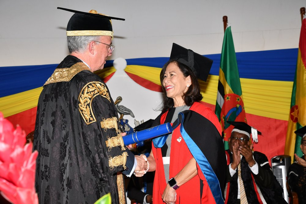 UWI chancellor Robert Bermudez presents the honourary degree to Donette Chin-Loy Chang