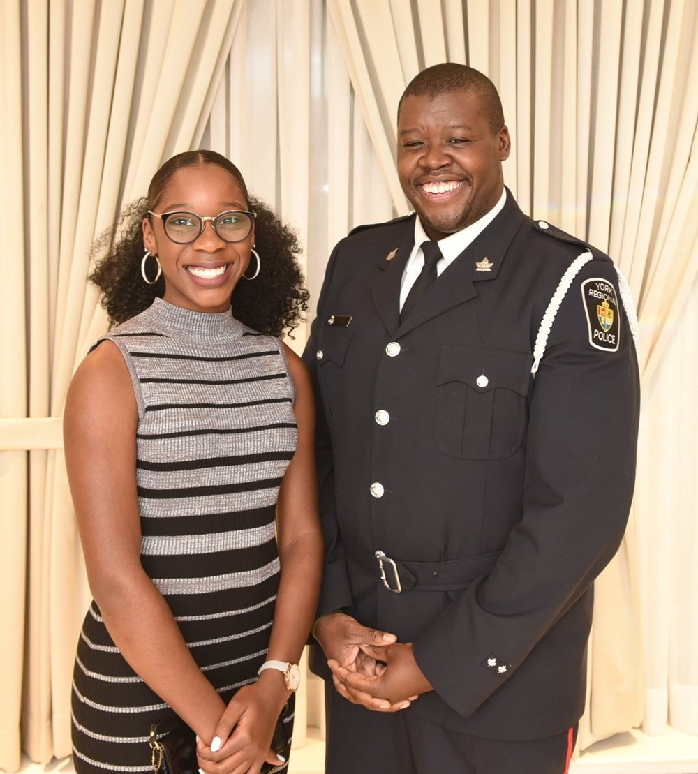 Const. Amaree Watkins presented a scholarship to Paris Dryden