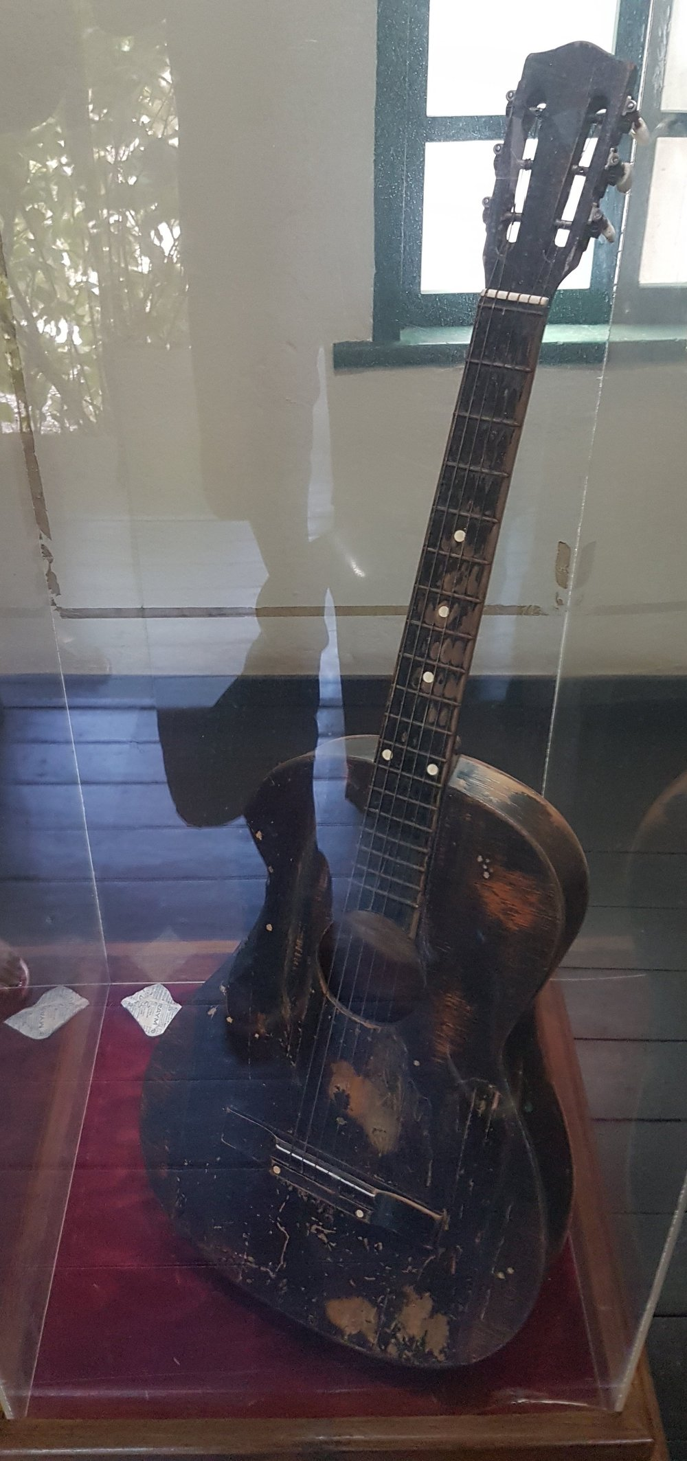 Bob Marley's first guitar on display at the Trenchtown Culture Yard Museum