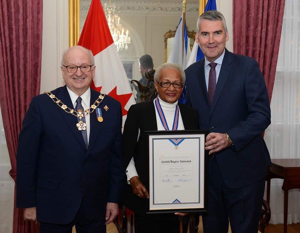 Nova Scotia premier Stephen McNeil (r) and governor general Arthur LeBlanc presented the Order of Nova Scotia to Clotilda Douglas-Yakimchuk