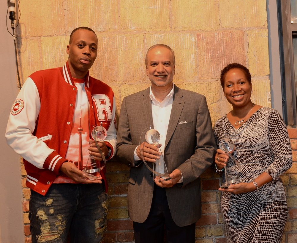 Dr. Juiiet Daniel with Tracker Networks Inc. chair and CEO Roger Mahabir (C) and rapper Kardinal Offishall
