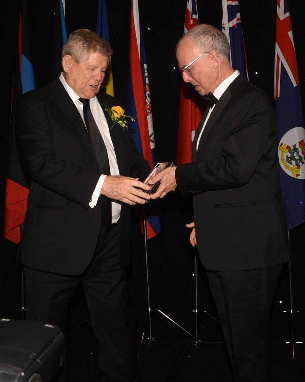 "Robert Bermudez (r) presented the Chancellor's Award to hotelier Gordon ""Butch"" Stewart"