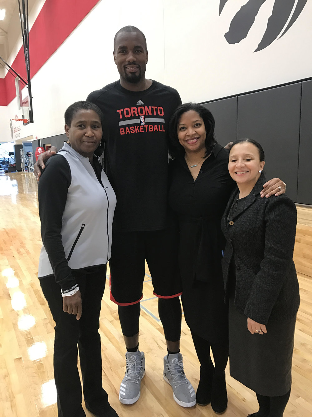 [L to R] At the Biosteele Centre Toronto, Ontario: Michele Roberts - Executive Director, NBPA; Serge Ibaka - Professional Basketball Player, NBA Toronto Raptors; Sherrie Deans - Executive Director, NBPA Foundation; Chrysa Chin - Executive Vice President, Strategy & Development, NBPA