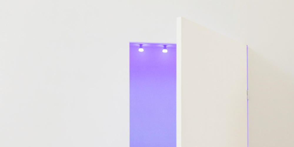 Chromophobia concept: A white door opening into a coloured space