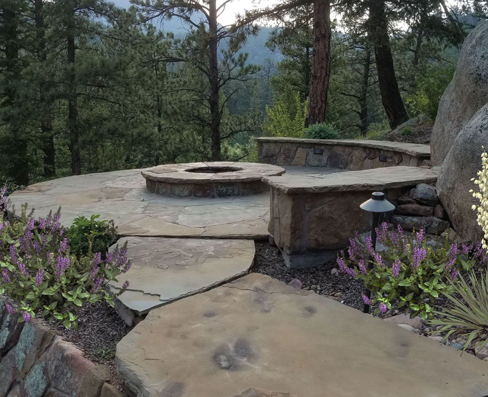 Firepit and seating is perched on the edge of the mountainside for dramatic views