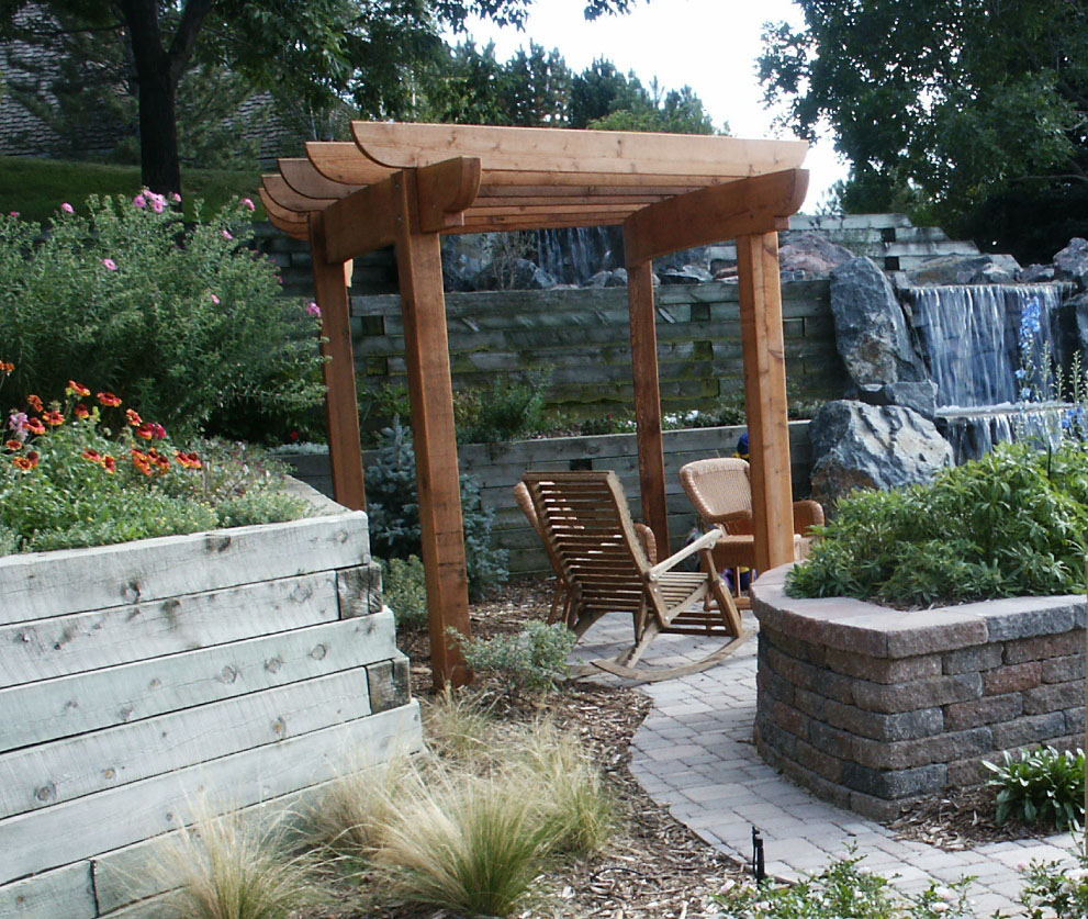 PATIO AND PERGOLA FOR ENJOYMENT OF WATER FEATURE