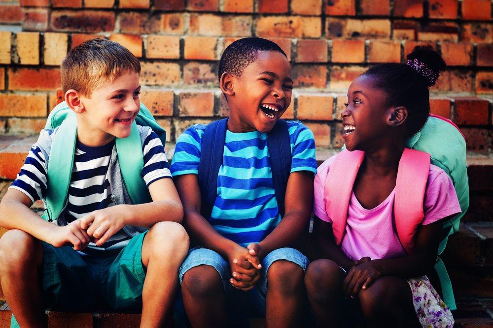 Happy children sitting on steps